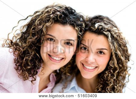 Portrait of some happy twin girls - isolated over white