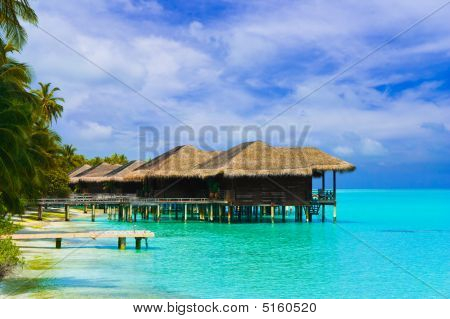 Water Bungalows On A Tropical Island