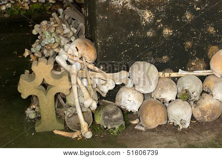 Stacked skulls inside the ossuary of Marville, France, with thousands of ancient skulls of 19th century and older