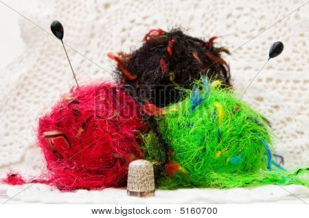 Colorful Knitting Yarns Over White Lace