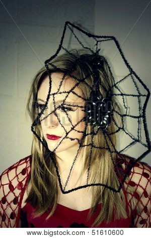 A witch with spider web