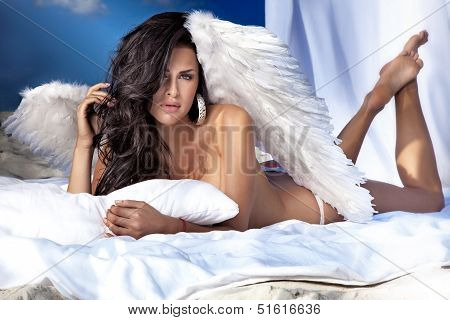 Cute Brunette Woman With White Wings.