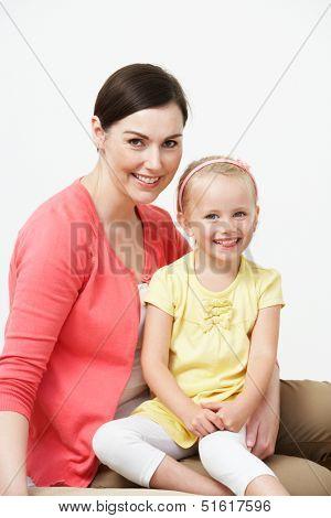 Studio Portrait Of Female Pre School Teacher With Pupil
