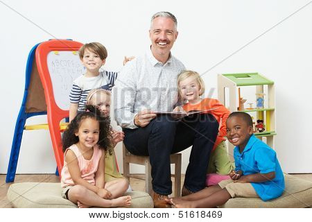 Pre School Teacher Reading Story To Children