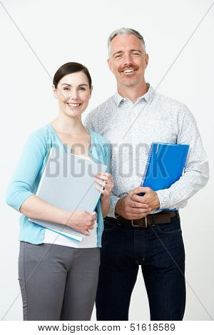 Studio Portrait Of Male And Female Pre School Teachers