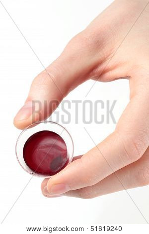 Hand Holding A Communion Cup