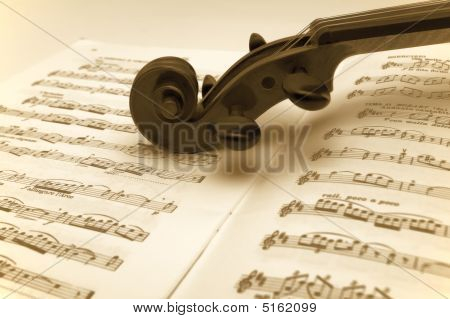 Vintage Violin Resting On A Sheet Music