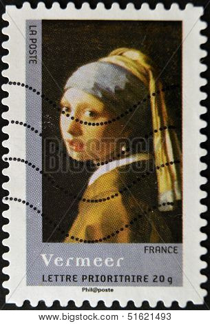 stamp printed in France shows Girl With a Pearl Earring by Johannes Vermeer