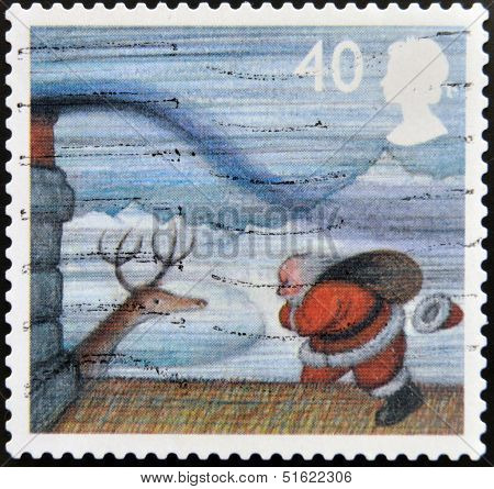 A stamp printed in Great Britain shows image of Santa Claus On Roof in Gale