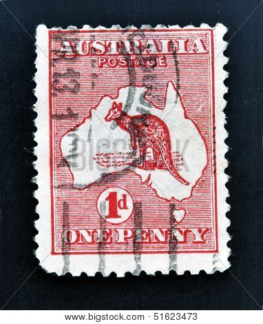 stamp printed in Australia shows kangaroo in the map one penny