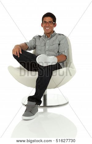 Man Relaxing In A Chair