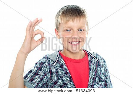 Enthusiastic Young Student Flashing A Perfect Sign