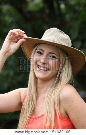 Vivacious Young Woman In A Trendy Hat