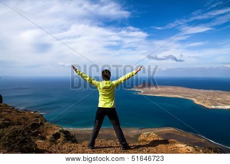 tourist woman on the top of rock
