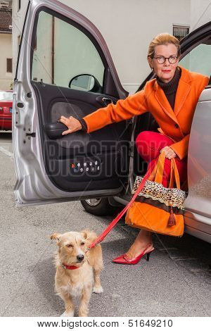 Stylish mature woman with her dog