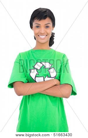 Happy black haired ecologist posing with crossed arms on white background