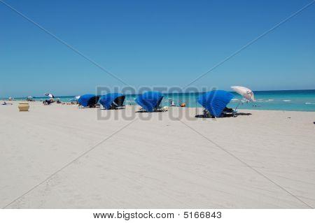 Row Of Cabanas At The Beach
