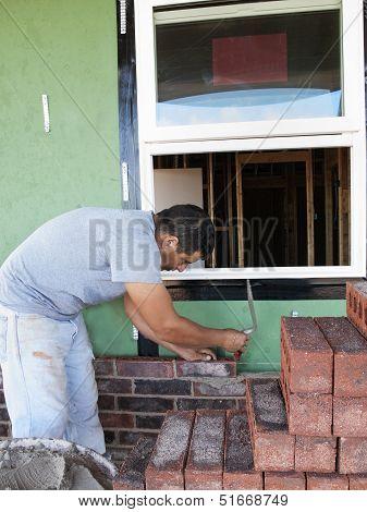 Brick Layer Lining Up The Bricks