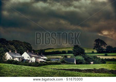 Rural hamlet with stormy skies