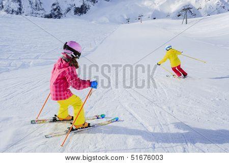 Ski, skiers on ski run - female skiers skiing downhill,  child on ski lesson