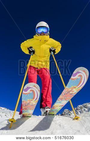 Ski, skier, sun and winter fun - woman enjoying ski vacation