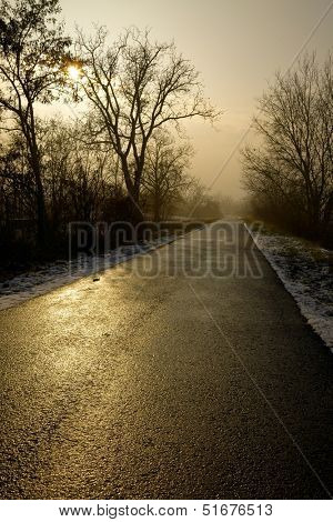 Long road through the winter countryside