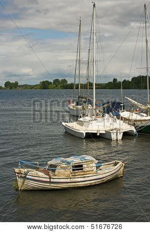 Abandoned Wooden Boat Moored In A Port River