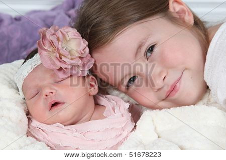 Sisters - Little girl with her newborn baby sister