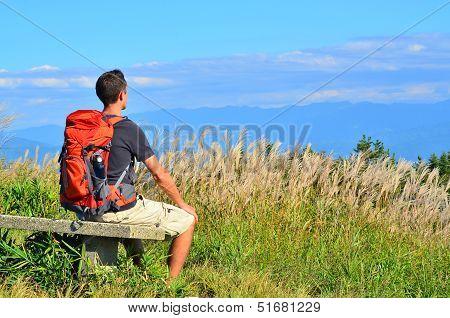 Hiker Rests on Bench