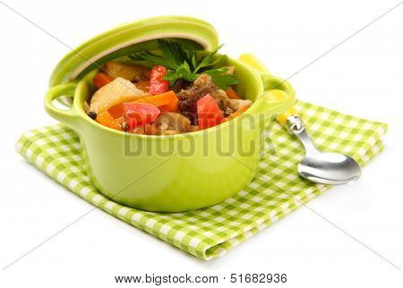 Homemade beef stir fry with vegetables in color pan, isolated on white