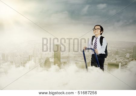 Cute Little Businessman above the cloud