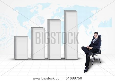 Businessman With Bar Chart And World Map Background