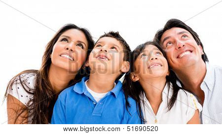 Happy family daydreaming and looking up - isolated over white background