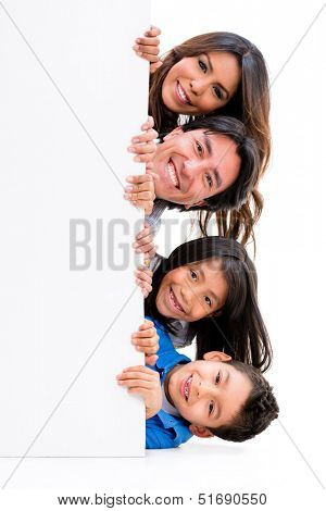 Fun family with a banner ad - isolated over a white background
