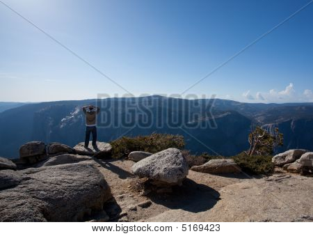 Male Hiker Looking At View From Yosemite Peak