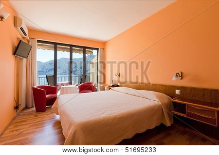 hotel room with exceptional views of the lake and mountains