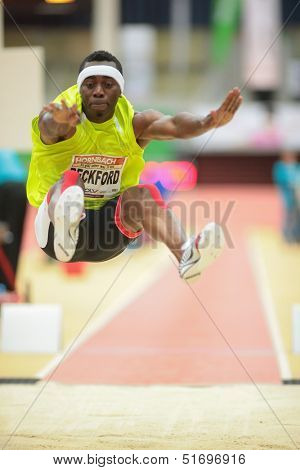 LINZ, AUSTRIA - JANUARY 31 ames Beckford (#511 Jamaica) places 3rd in the men's long jump event on January 31, 2013 in Linz, Austria.