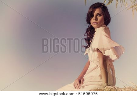 Ethereal beautiful young woman in vintage dress