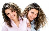 Portrait of some happy twins - isolated over a white background
