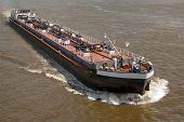 image of fuel tanker  - A large fuel cargo ship on a river - JPG