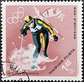 A stamps printed in Hungary showingan athlete skiing Winter Olympic sports in Grenoble 1968