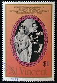 A stamp printed in St. Vincent shows portrait of Elizabeth II and the Duke of Luxembourg