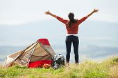 stock photo of sleeping bag  - Teenage Girl On Camping Trip In Countryside - JPG