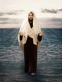 stock photo of yeshua  - Jesus Walks on Water with the light behind him - JPG