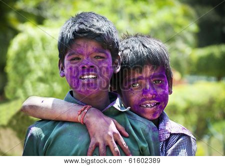BANGALORE, INDIA - MARCH 8: Two unidentified young boys with face painted in colors celebrates the f