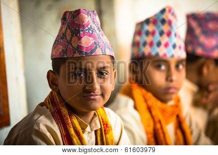 KATHMANDU, NEPAL - DEC 9, 2013: Unknown children during the reading of texts in Sanskrit at Jagadguru School. School established at 2013 to let preserve Hindu culture.