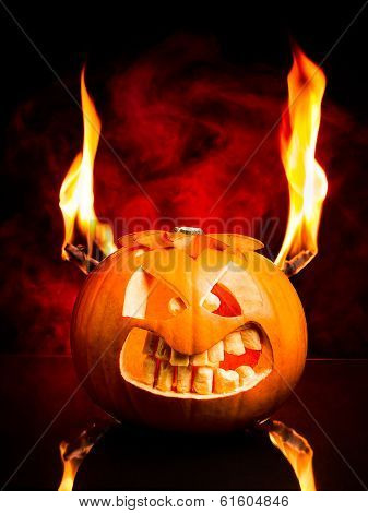 Evil face of Halloween pumpkin with flames