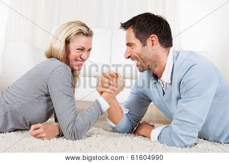 Man And Woman Arm Wrestling