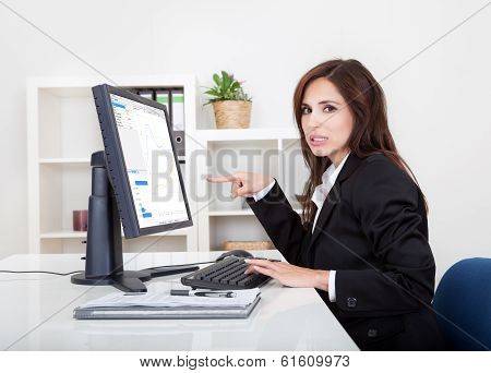 Businesswoman Showing Graph