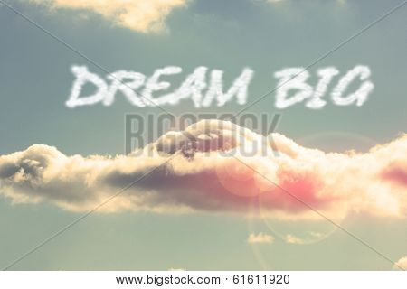 The word dream big against bright blue sky with cloud